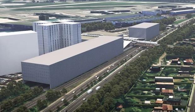 Sådan kan p-husene i forbindelse med den nye togstation i lufthavnen komme til at se ud. (Visualisering: Sund & Bælt)